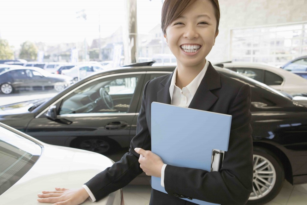 female salesclerk of car dearlership