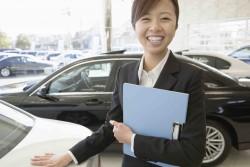 female salesclerk of car dearlership